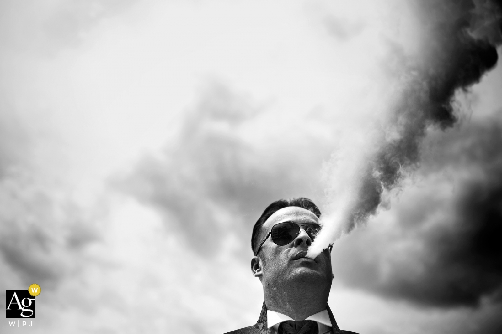 black and white creative photography detail | man blowing vapor clouds