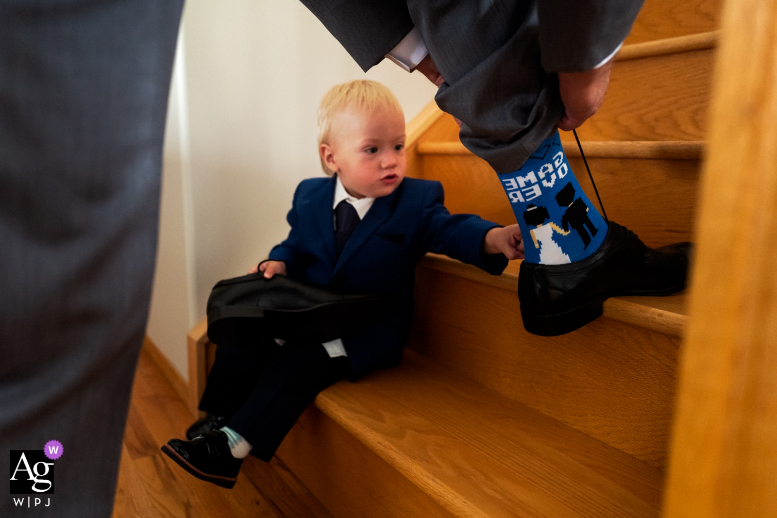 Alberta pictures by a creative wedding photographer | detail of groom's socks with toddler boy