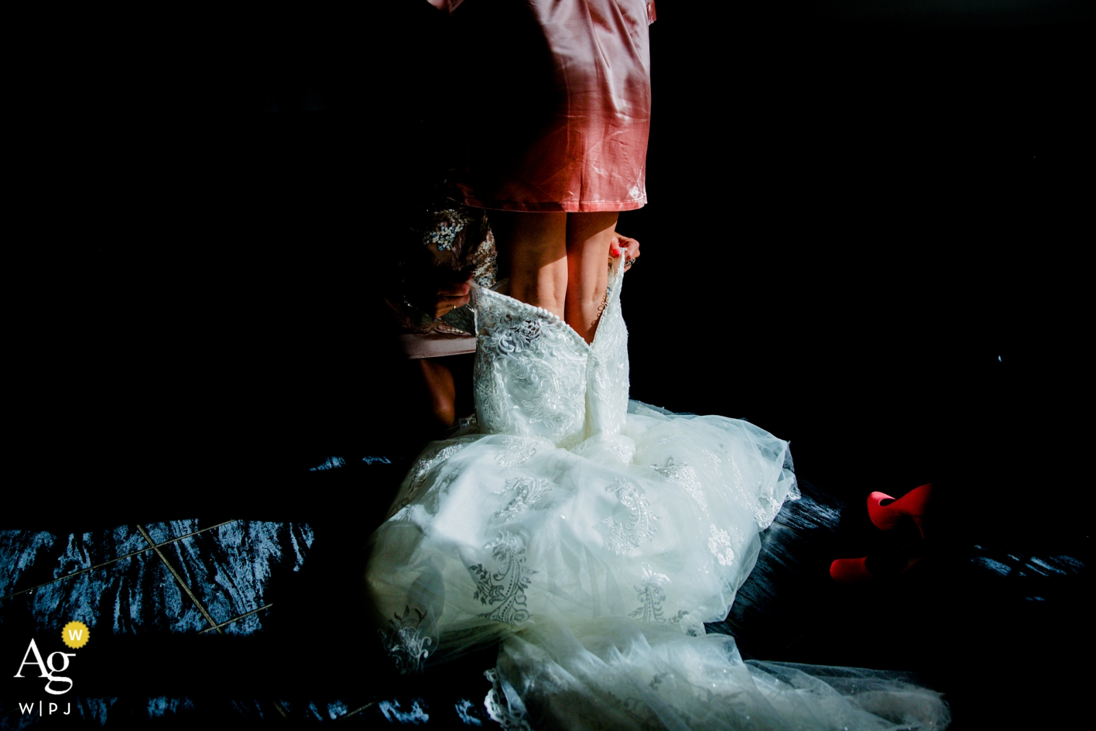 Netherlands artistic creative photography detail of wedding dress going on