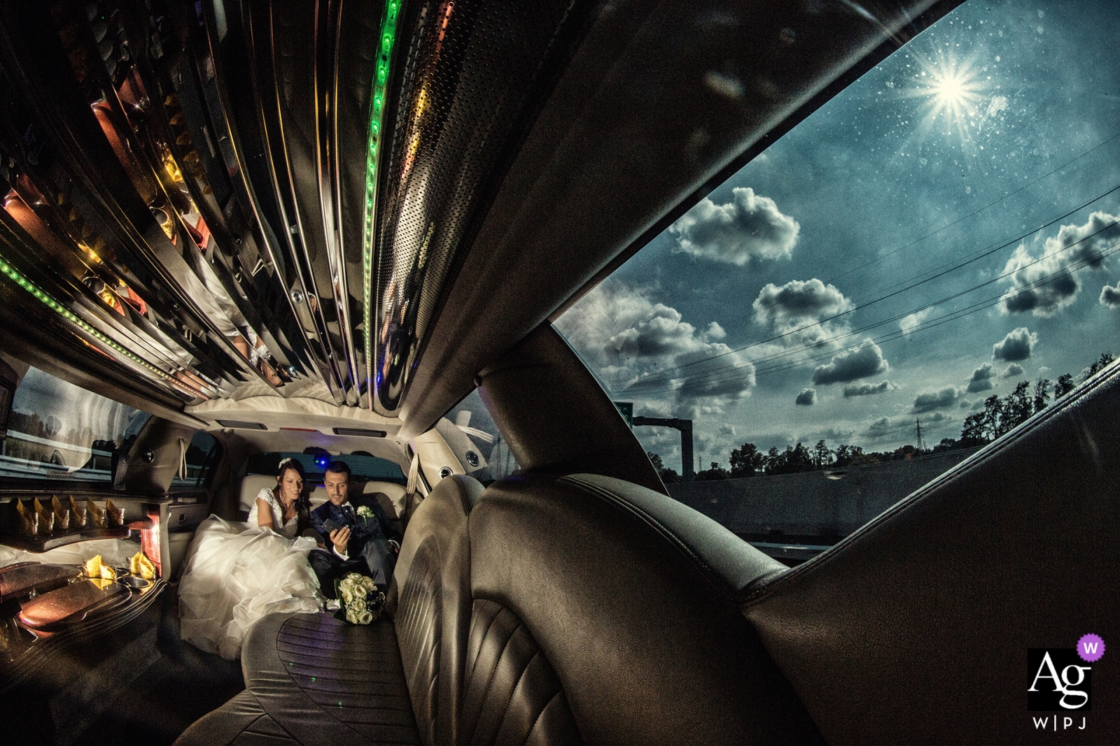 artistic wedding photo during Lombardy portrait session with bride and groom in limo