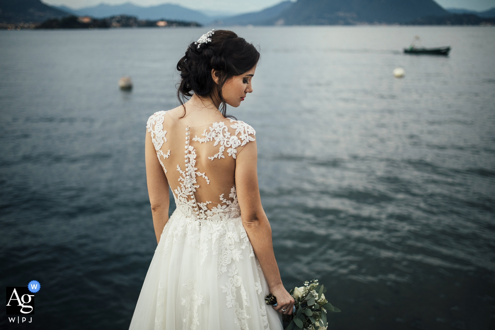 Piedmont wedding day bride portrait at the water showing back of dress and bouquet