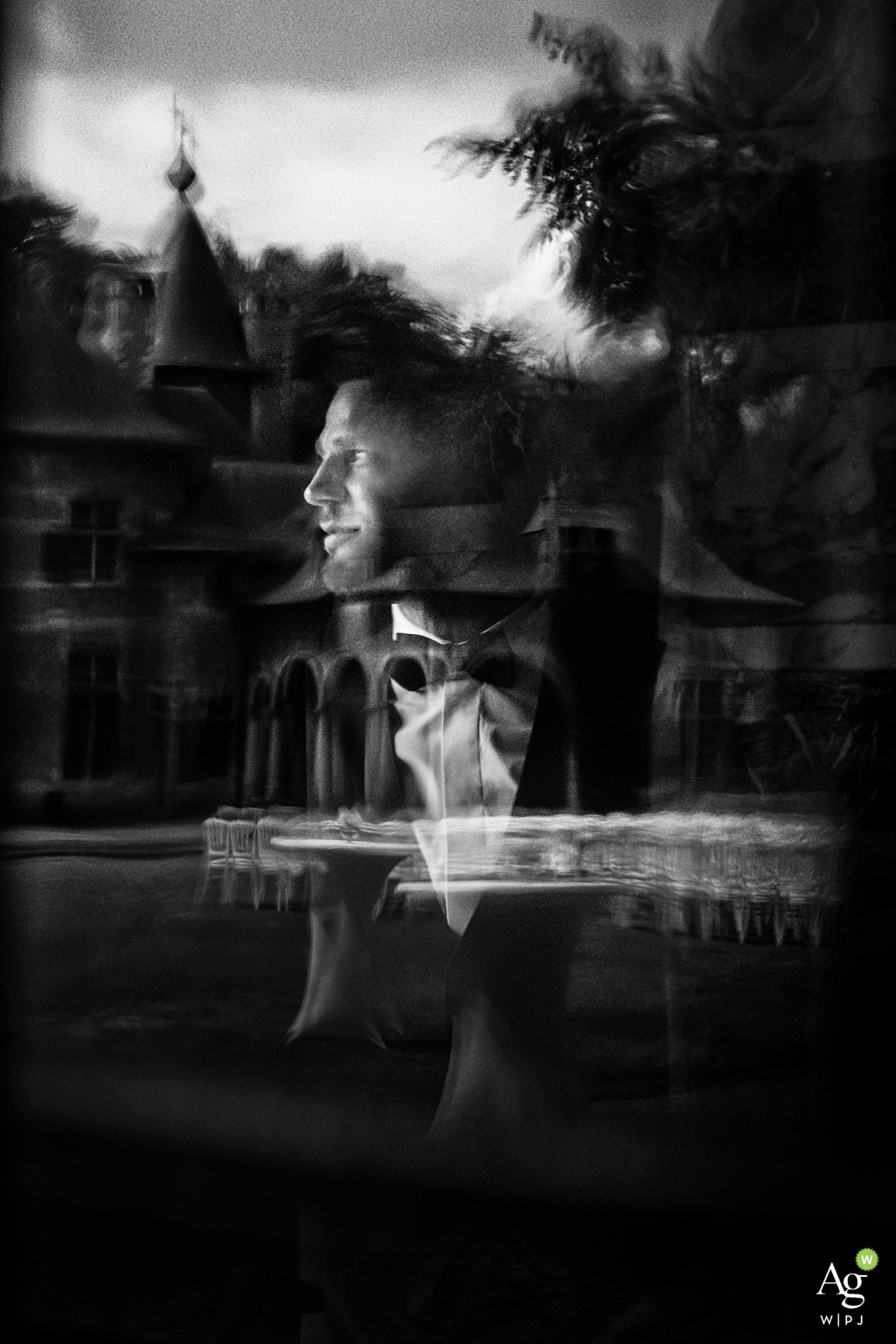 Czech Republic vertical portrait of a profiled groom with reflections in black-and-white