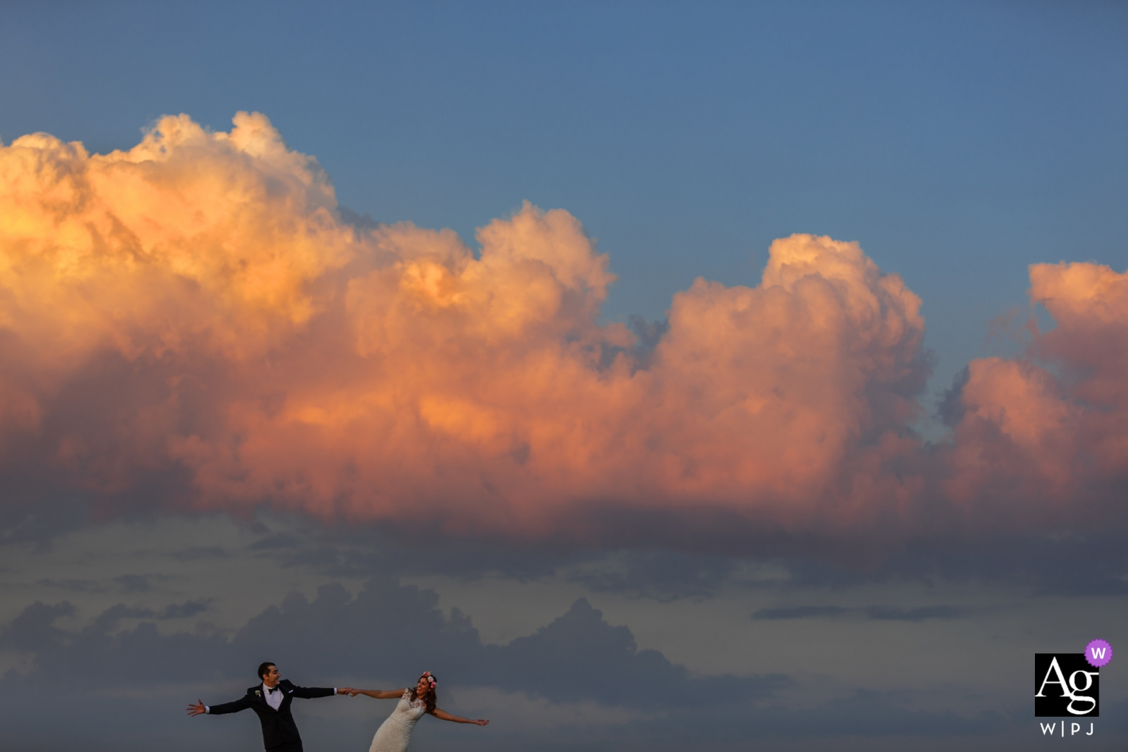 artistic wedding photo during a Florence portrait session | big clouds and big sky