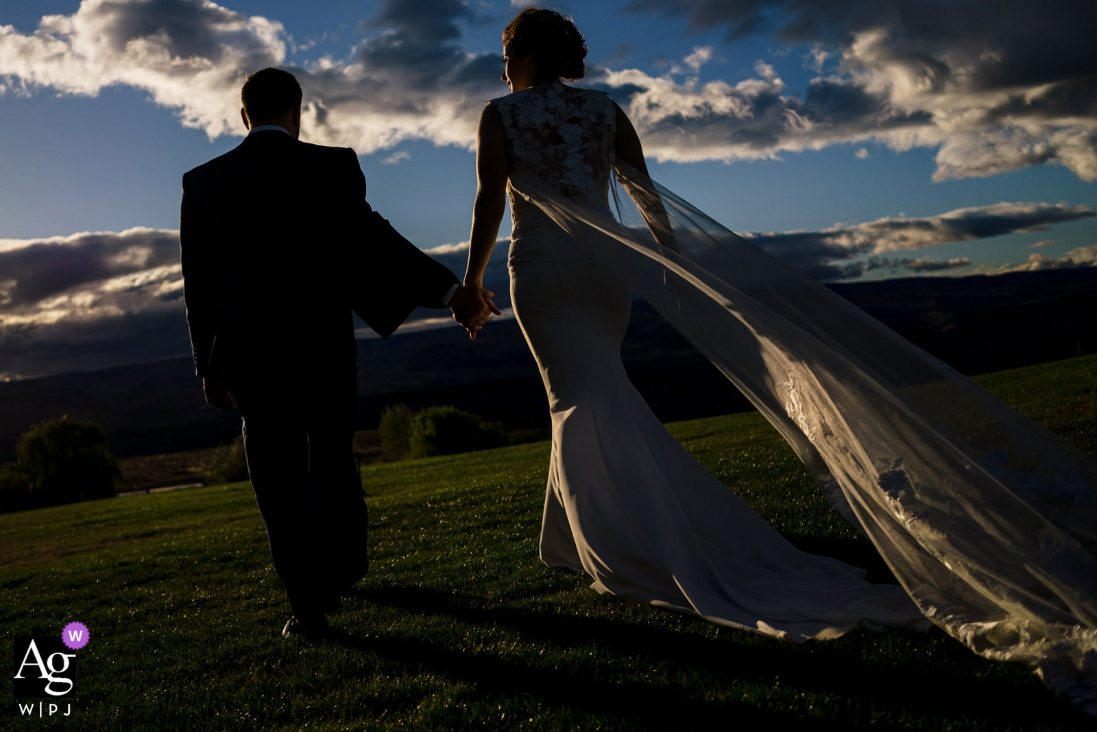 Wedding photo of couple walking into sun with clouds | Wedding day portraits captured in Seattle, Washington