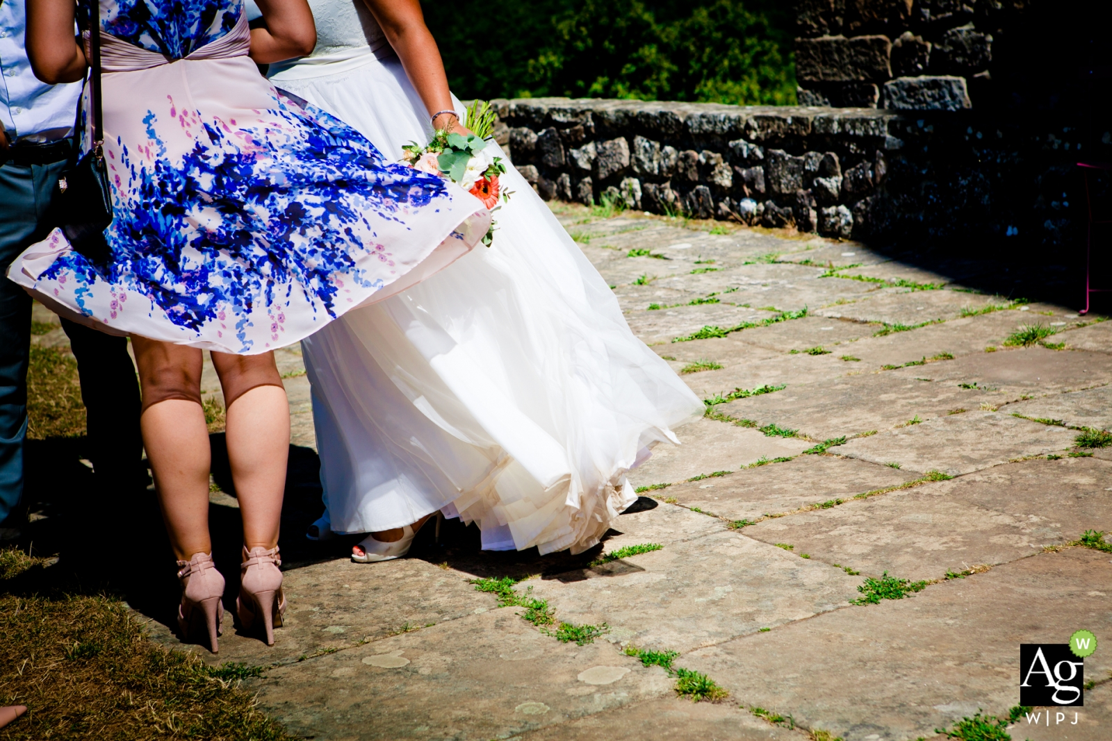 Air and dress photography - windy wedding reception with bride