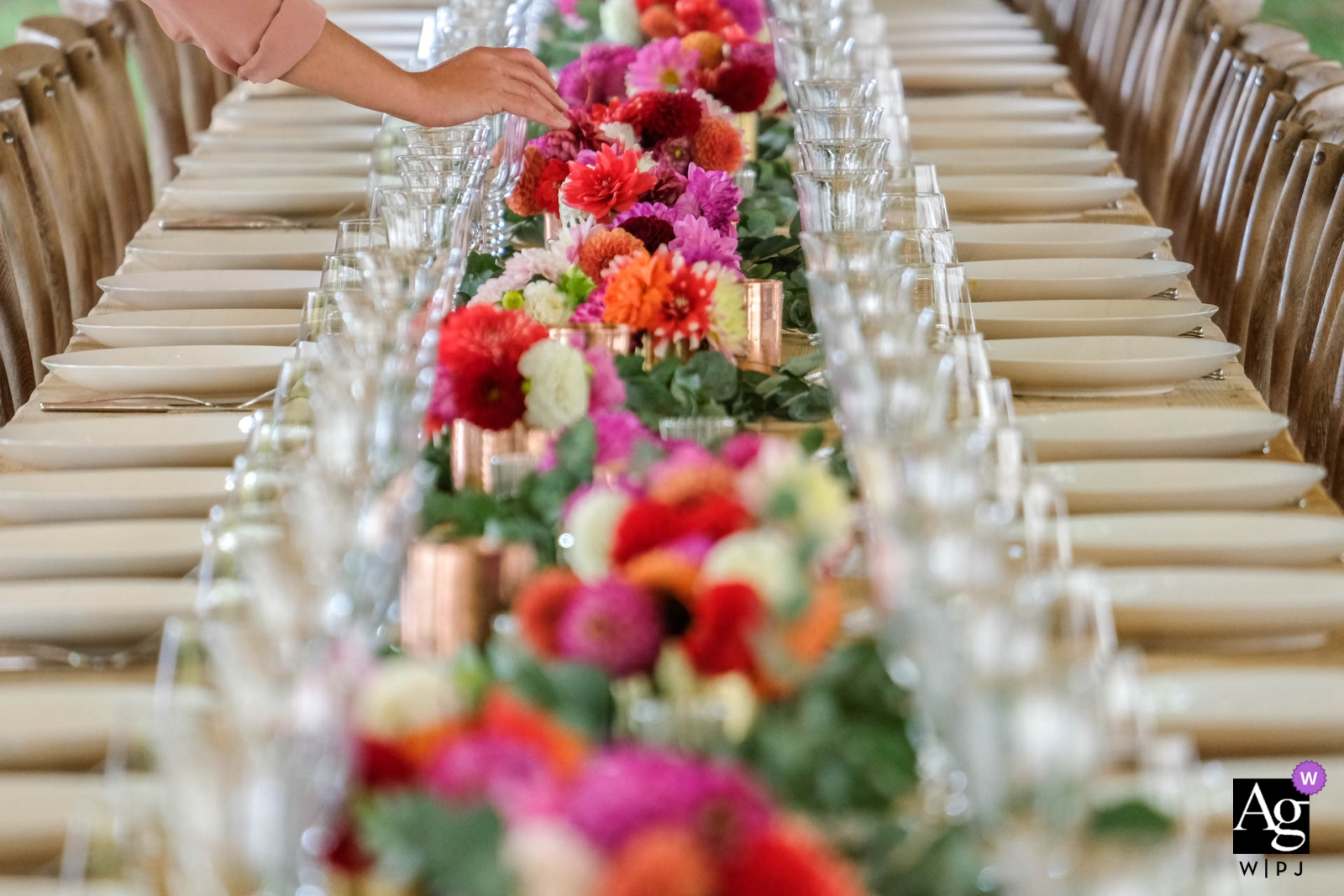 wedding table setting with flowers down the center