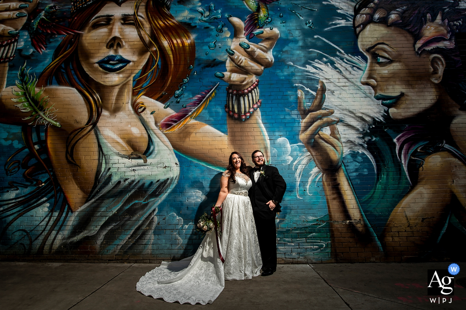The Grand Hyatt Denver wedding photographer | Bride and groom portrait outside with graffiti mural