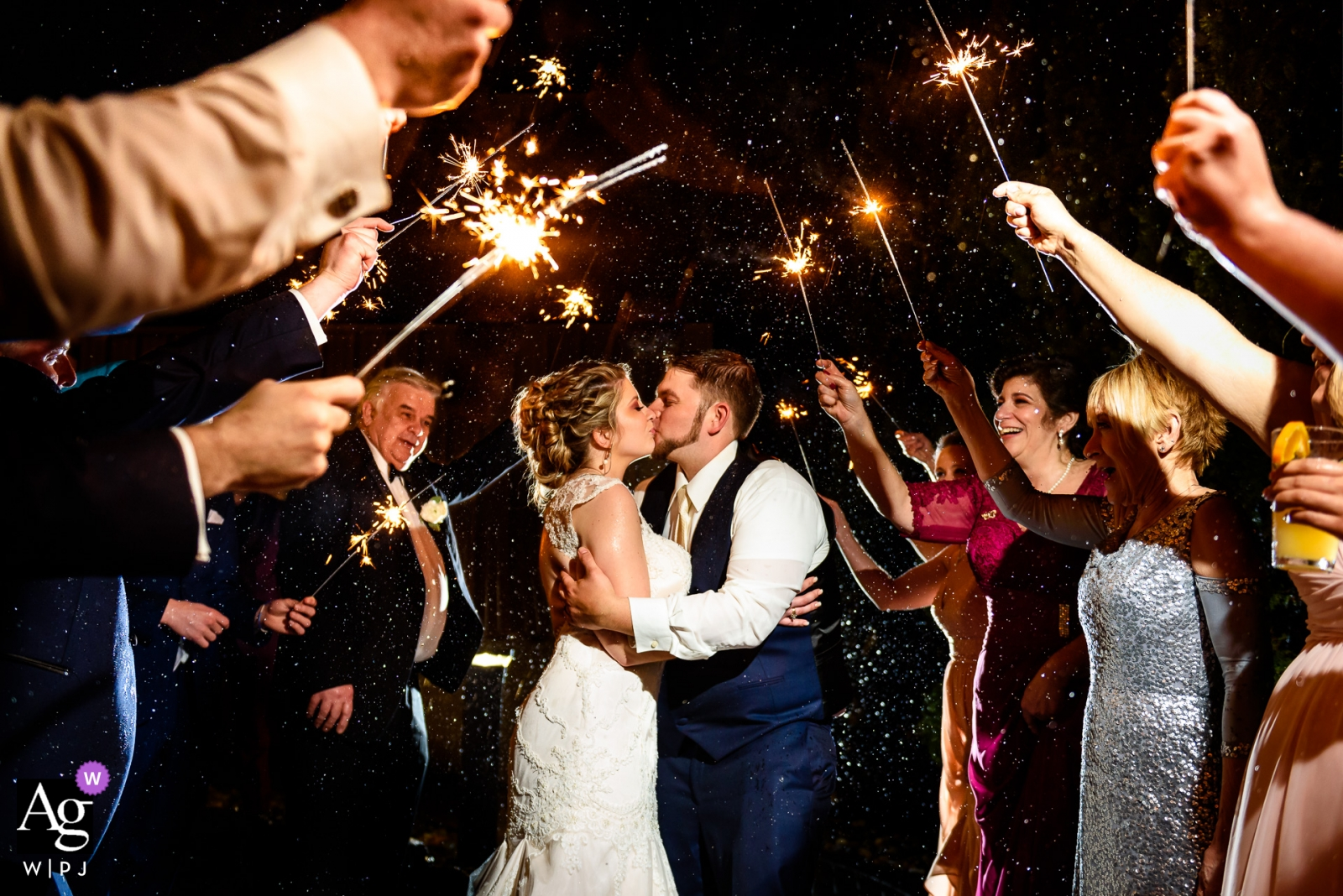 Rock Island Lake Club wedding photography - Rain did not stop this couples sparkler exit
