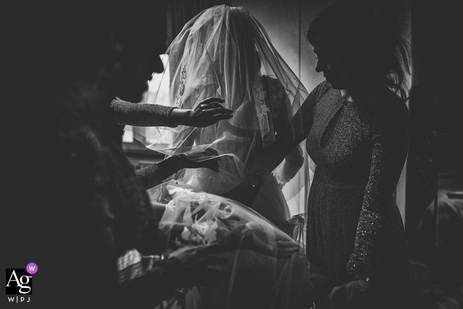 Pisa Black and white wedding photography | getting ready details with the bride and her entourage helping