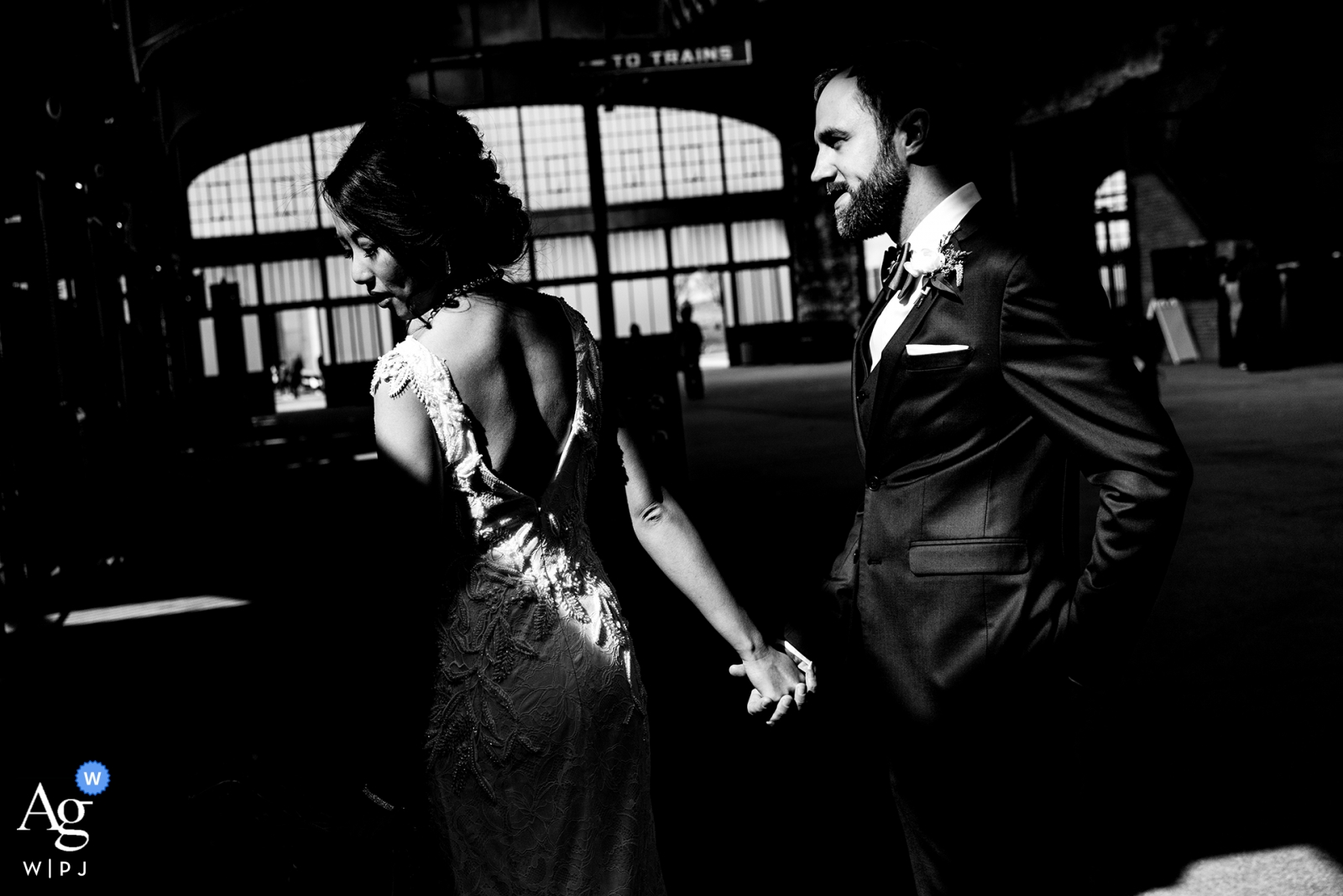 maritime parc, nj wedding photographer | train station portrait session on wedding day in black-and-white