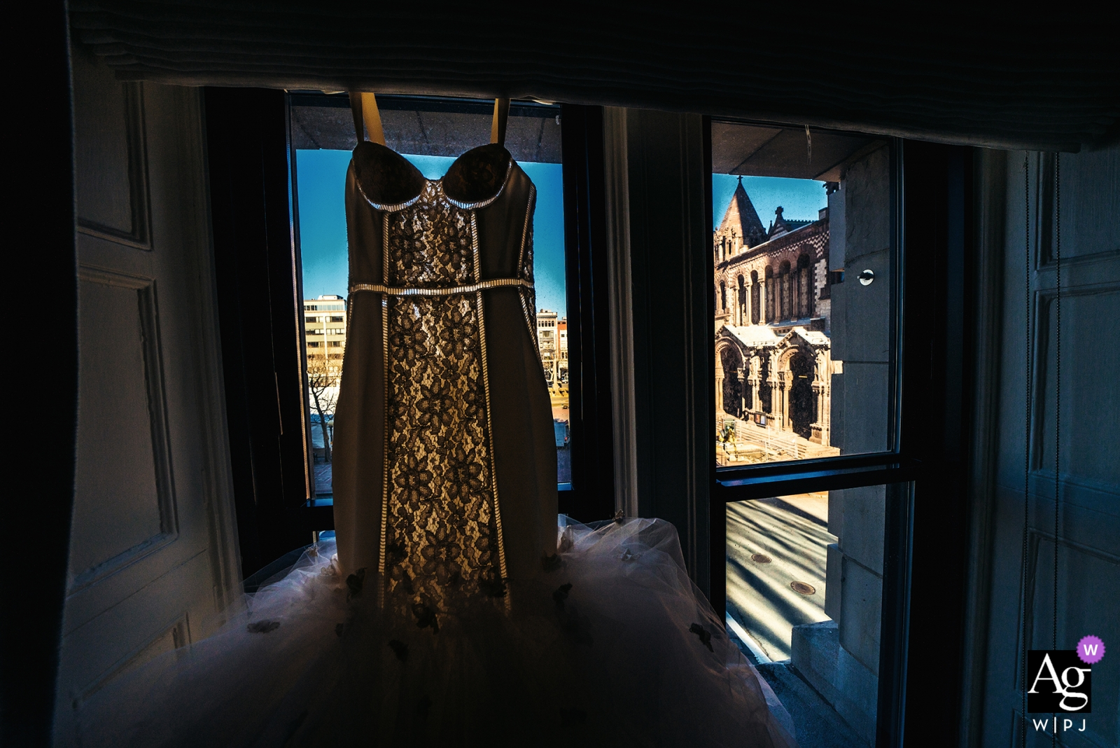 Fairmont Copley Plaza wedding photographer | wedding dress hanging in a window before the ceremony and reception