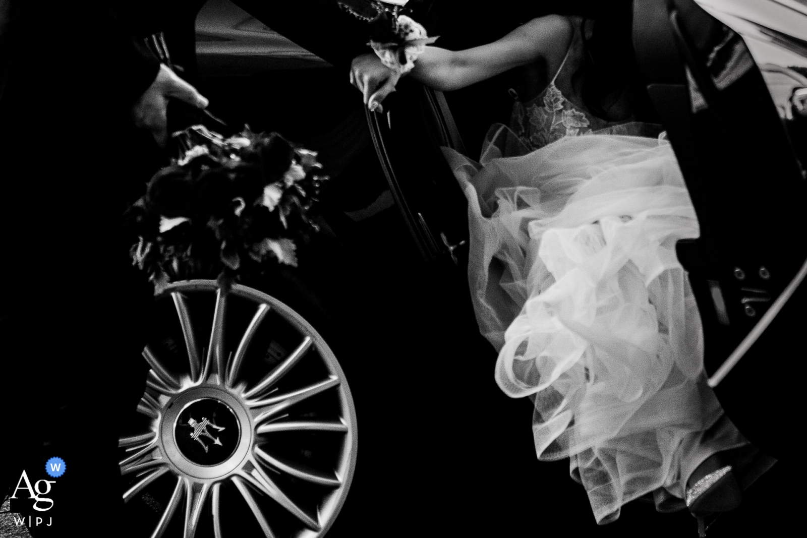 China photographer for weddings - the bride exits a fancy car before she enters her Wedding reception