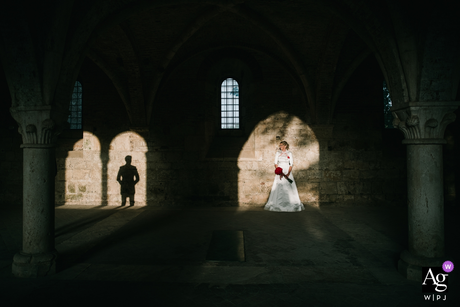 San Galgano Abbey, Siena photography | Tuscany wedding day portrait photography with the bride and groom in the shadows and sunlight