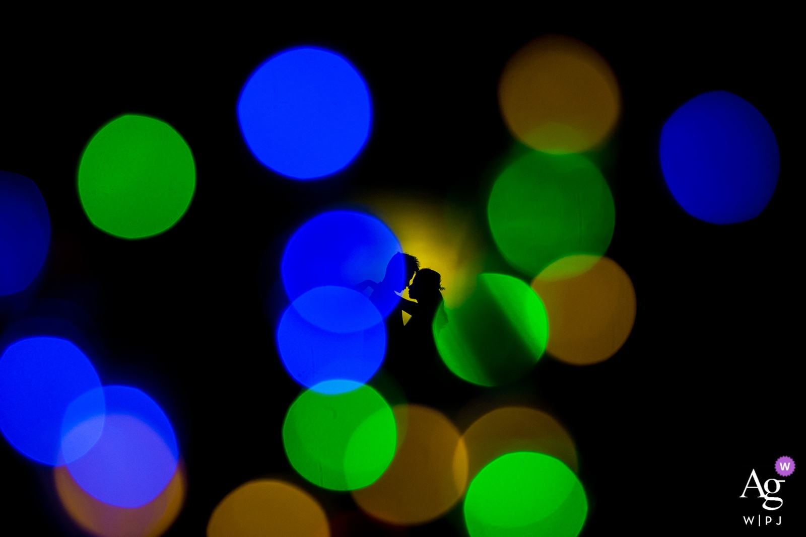 outdoor bride and groom portrait at the underground garage - Colorful light bokeh