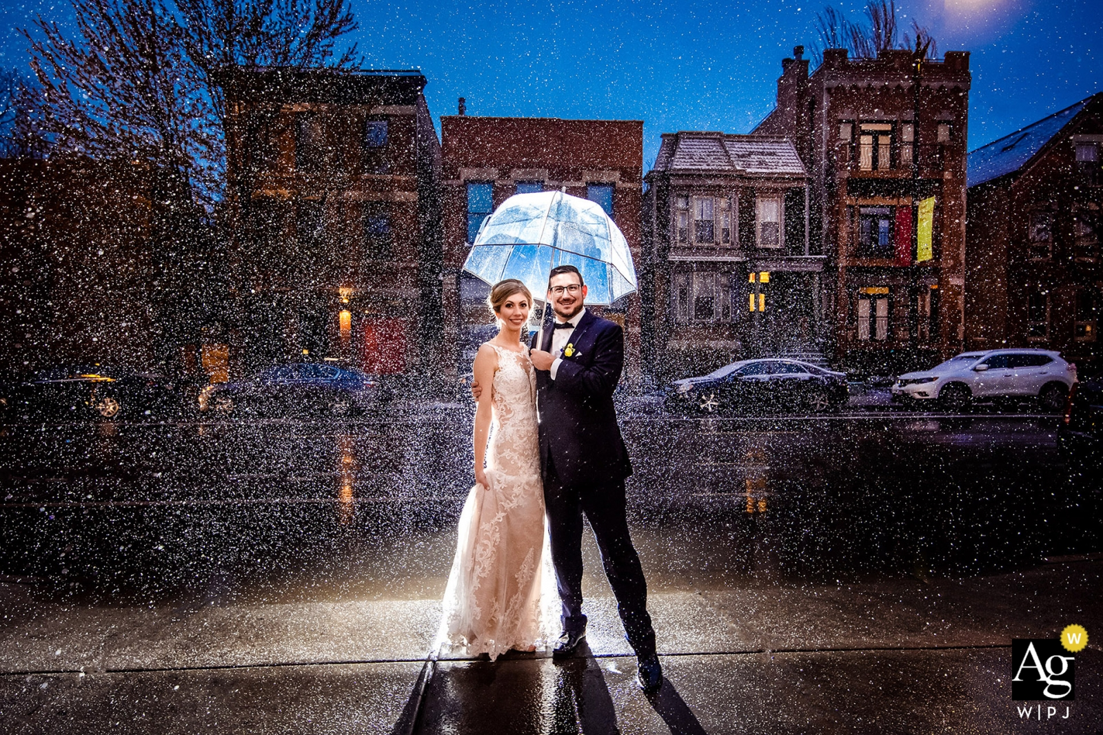 floating gallery chicago bride and groom portraits in the rain under an umbrella | Illinois wedding photographer