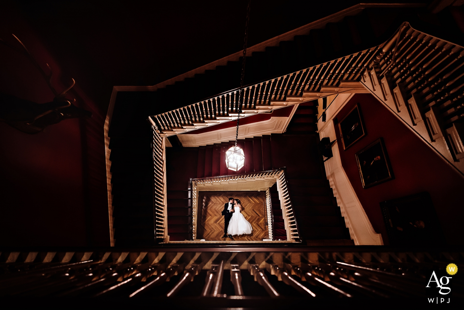 Wedding photography at the Harvard Club of New York City - Bride & groom portrait from above looking through the stairs