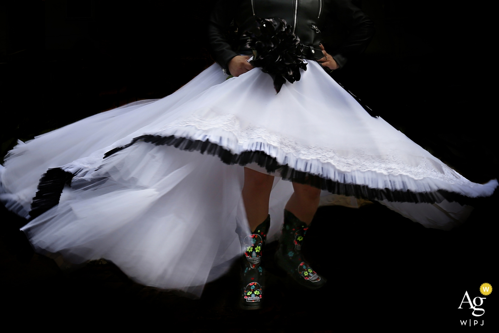 Goiás wedding photography | Brazil bride shows off her boots under her black trimmed wedding dress