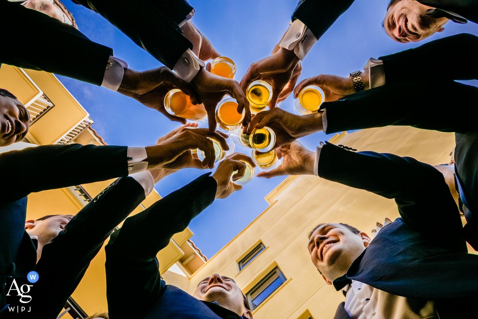 Palos Verdes, California wedding photographer - Groomsmen Cheers, a toast shot from down below