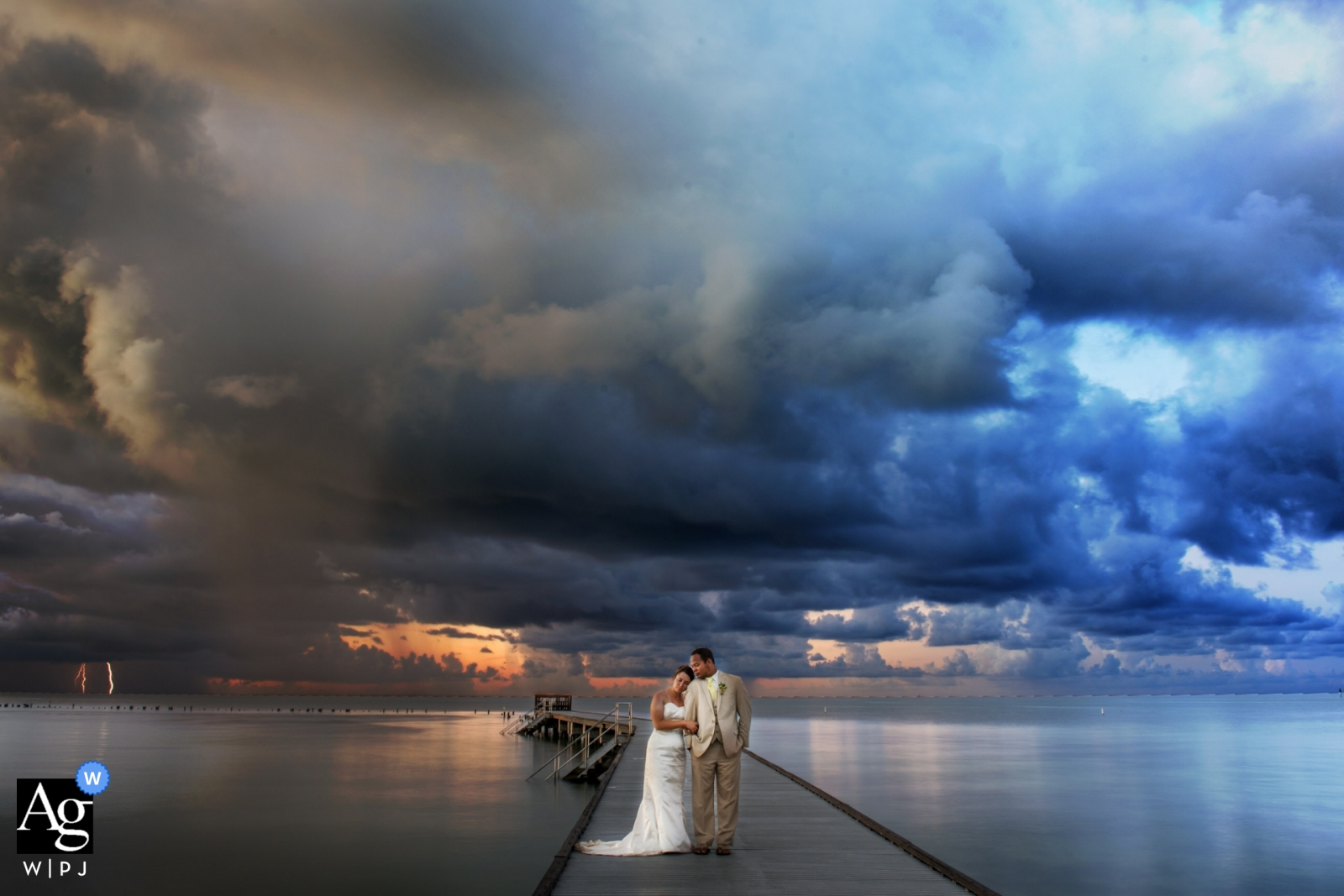 Key West wedding portrait of couple at the water with a lighting strike in the distance