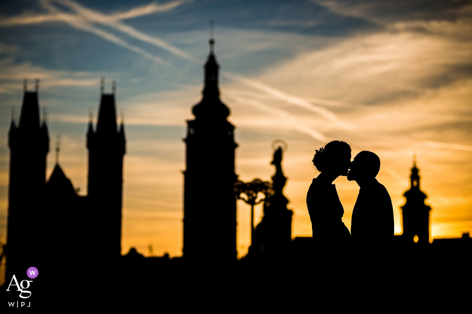 Nové Adalbertinum Photos - Bride and groom kiss at the sunset evening skyline