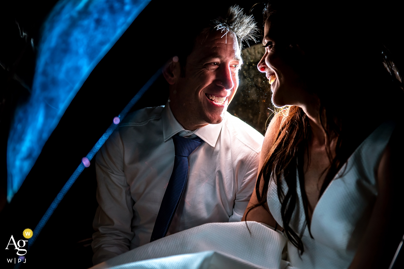 Nighttime wedding portrait of the bride and groom at The St. Vrain