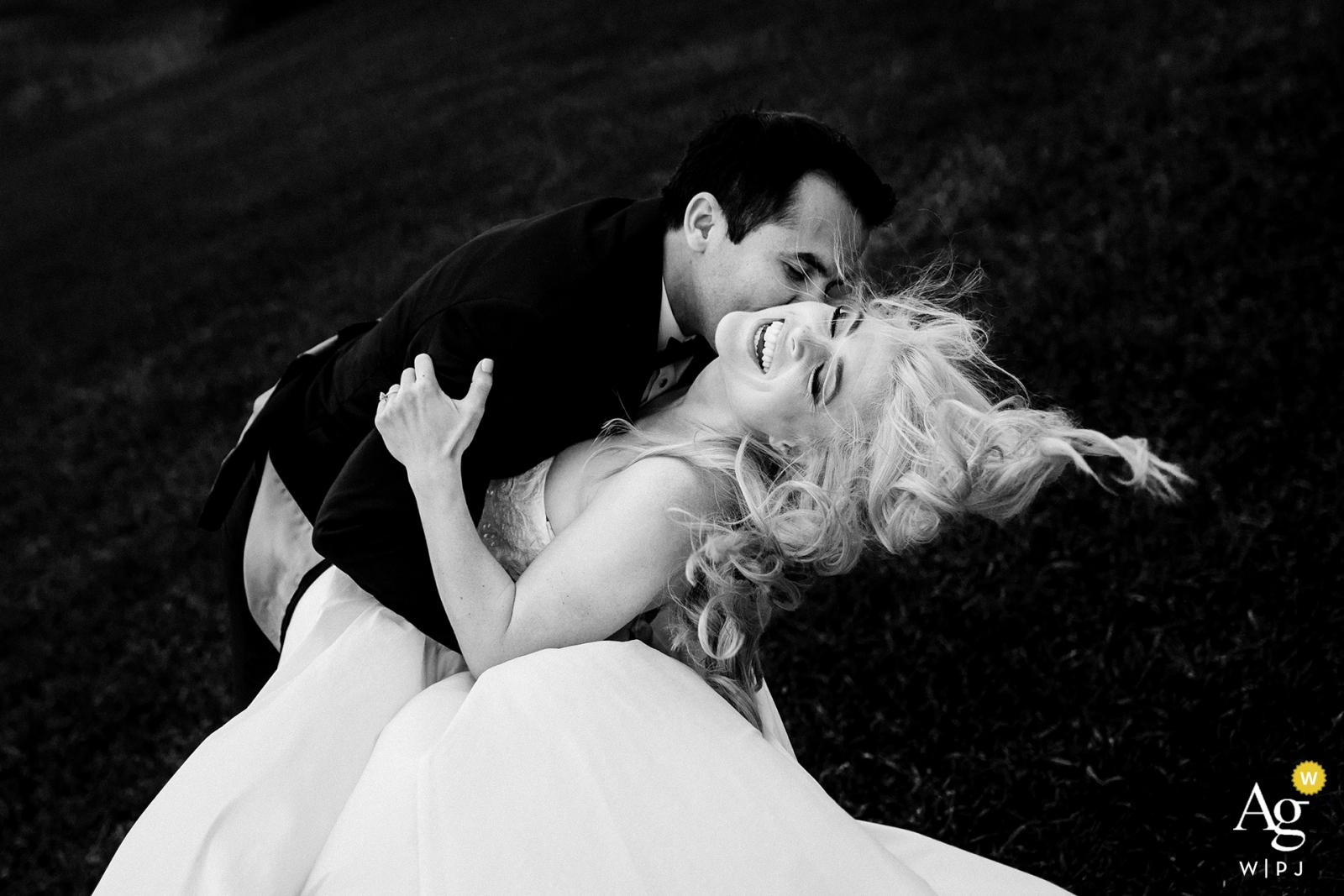 The bride & groom playing in the wind for their pre-ceremony portraits before their Hotel Jerome Wedding.