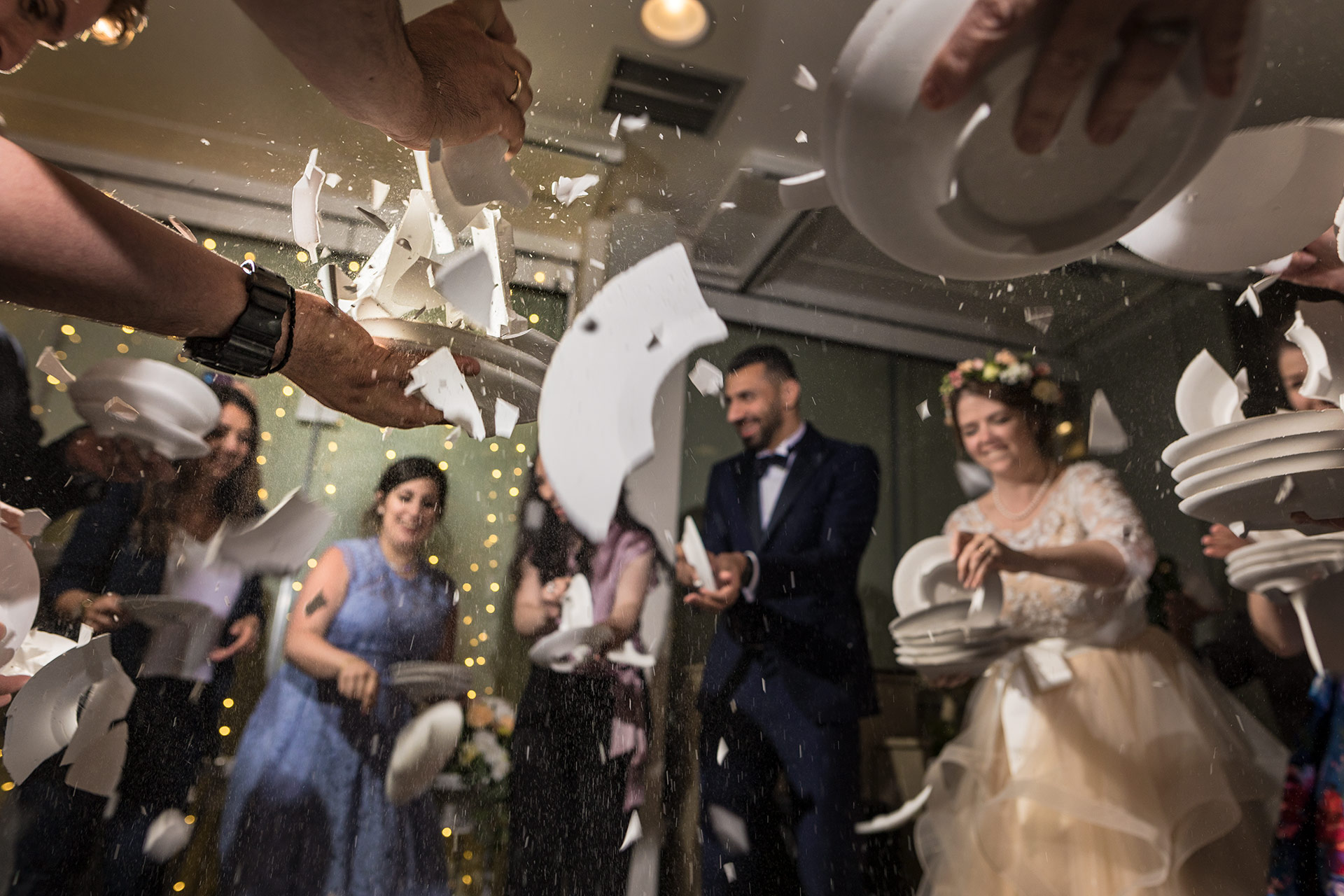 Fleeting memories are bottled in a wedding photograph of plate smashing.