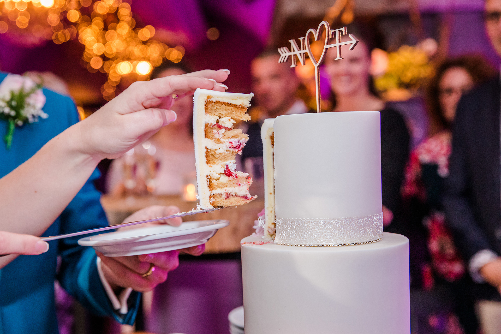Wedding photo of the cake cutting moment turned into a beautiful detail shot.