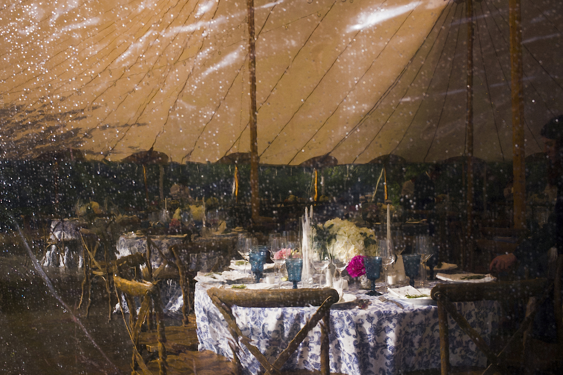 Rain on wedding reception tent sides - Bad weather wedding photography