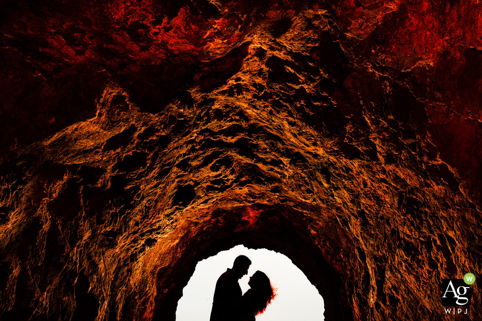 san francisco portrait of the bride and groom in an arched, rock cave in silhouette style