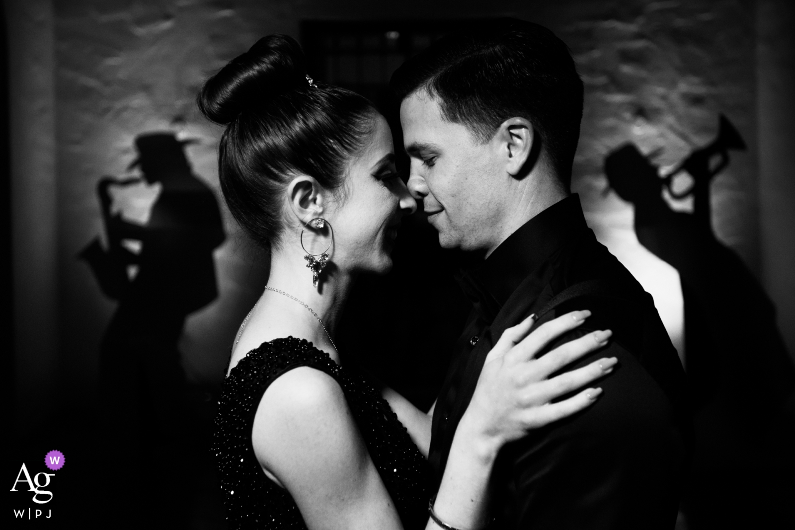 Wedding day portrait of the bride and groom on the dance floor of the reception at  Villa Woodbine, Miami, Florida