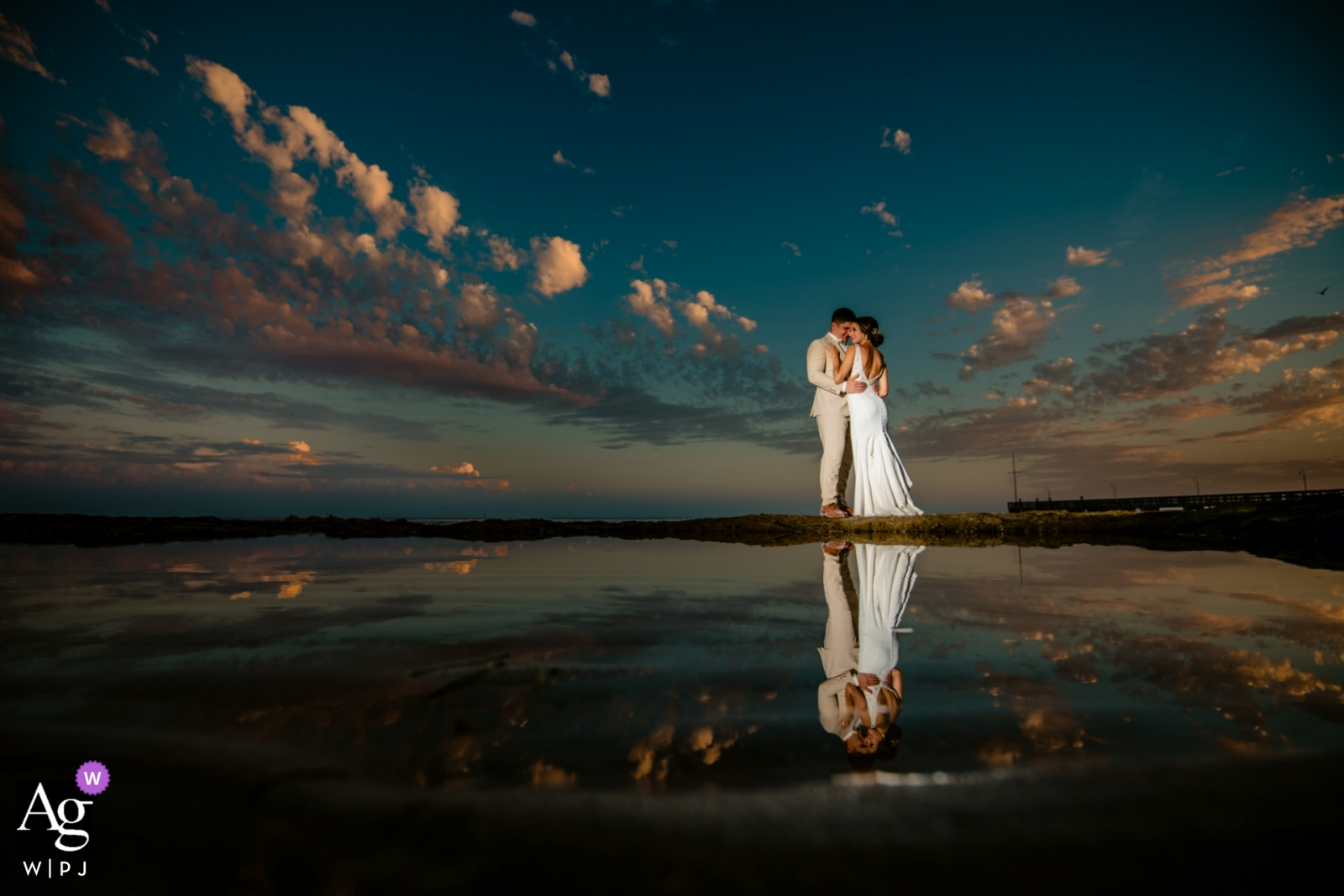 Casa Marina Resort Key West wedding photographer:Sunsets in Key West are something special. When its low tide the limestone rocks expose themselves, which gives you perfect tide pools for reflections.