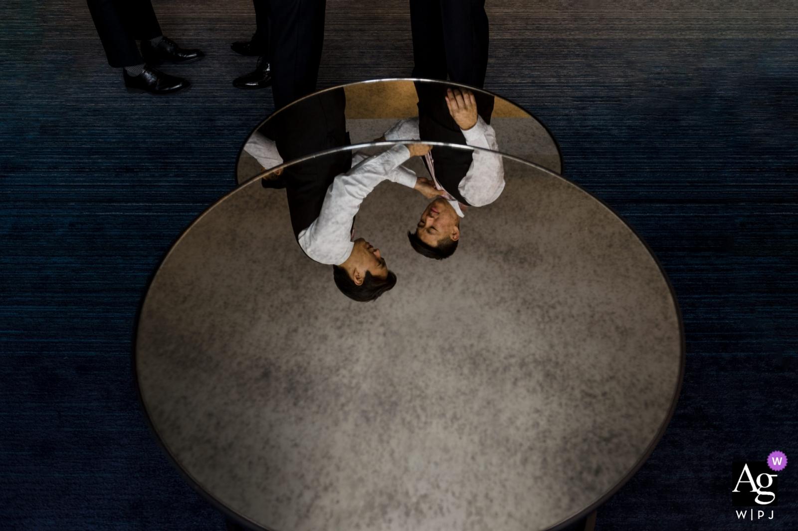 W Hotel Midtown Atlanta wedding venue pictures: Getting Ready reflection of groomsmen