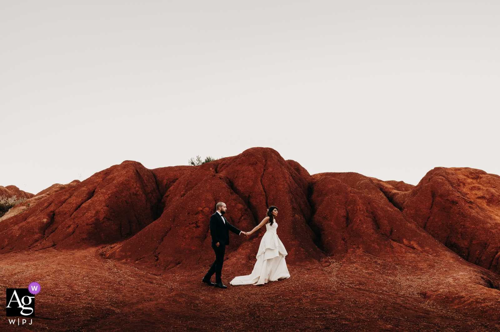Apulia wedding photography - walking in a red clay quarry, in Puglia