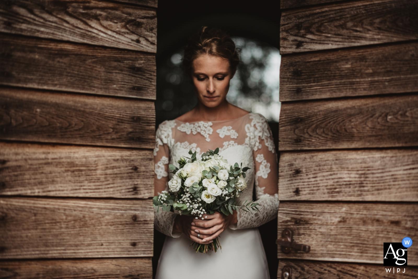 Ferranesi Fine Art Wedding Portrait of The Bride holding Bouquet of Flowers