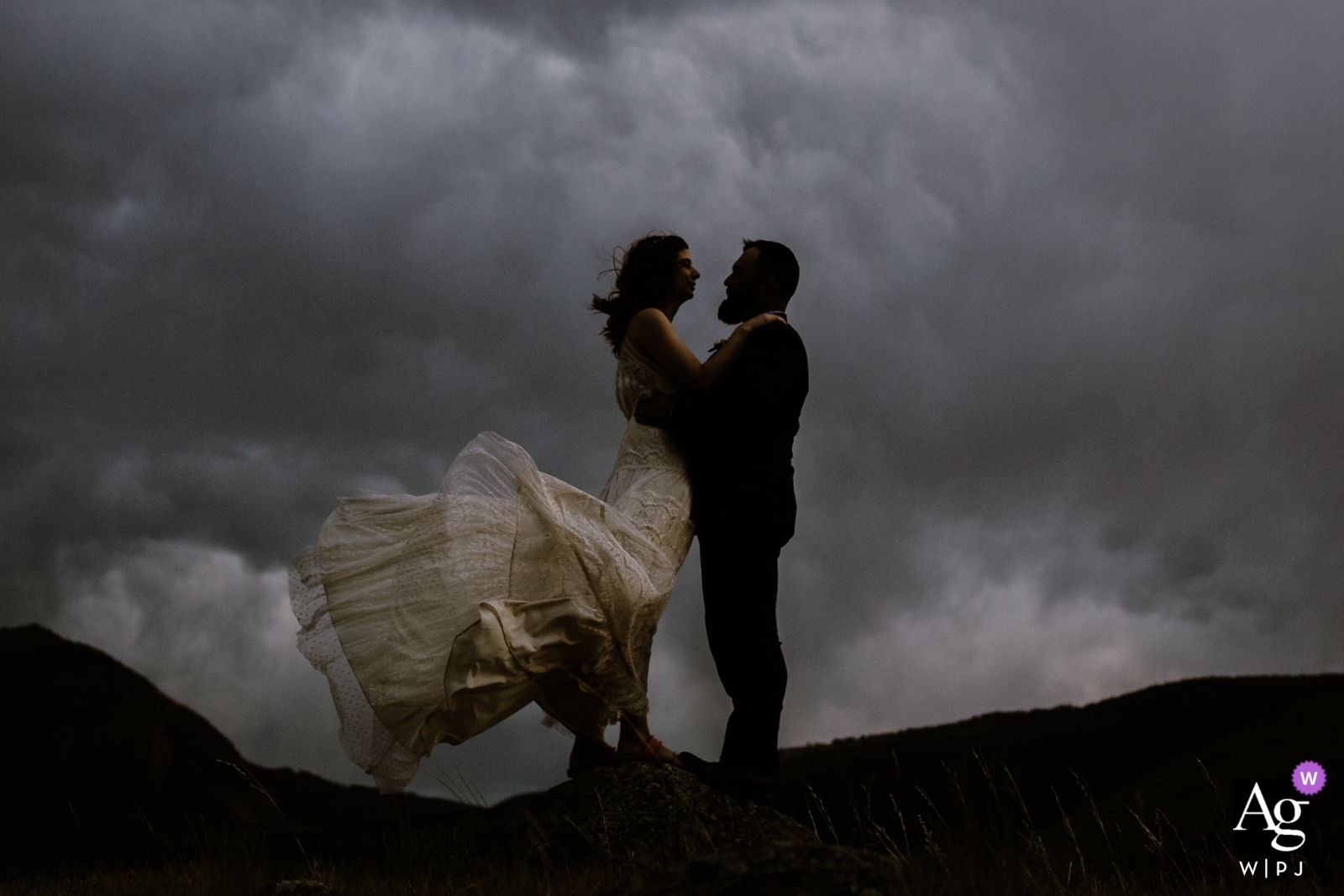 Yellowstone portrait of the bride and groom with clouds and wind