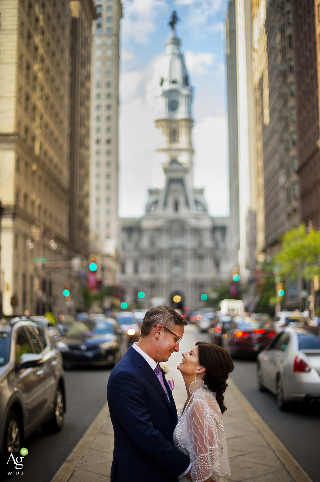 Broad Street - Philadelphia, PA wedding photography | A bride and groom embrace each other along Broad Street in Center City.