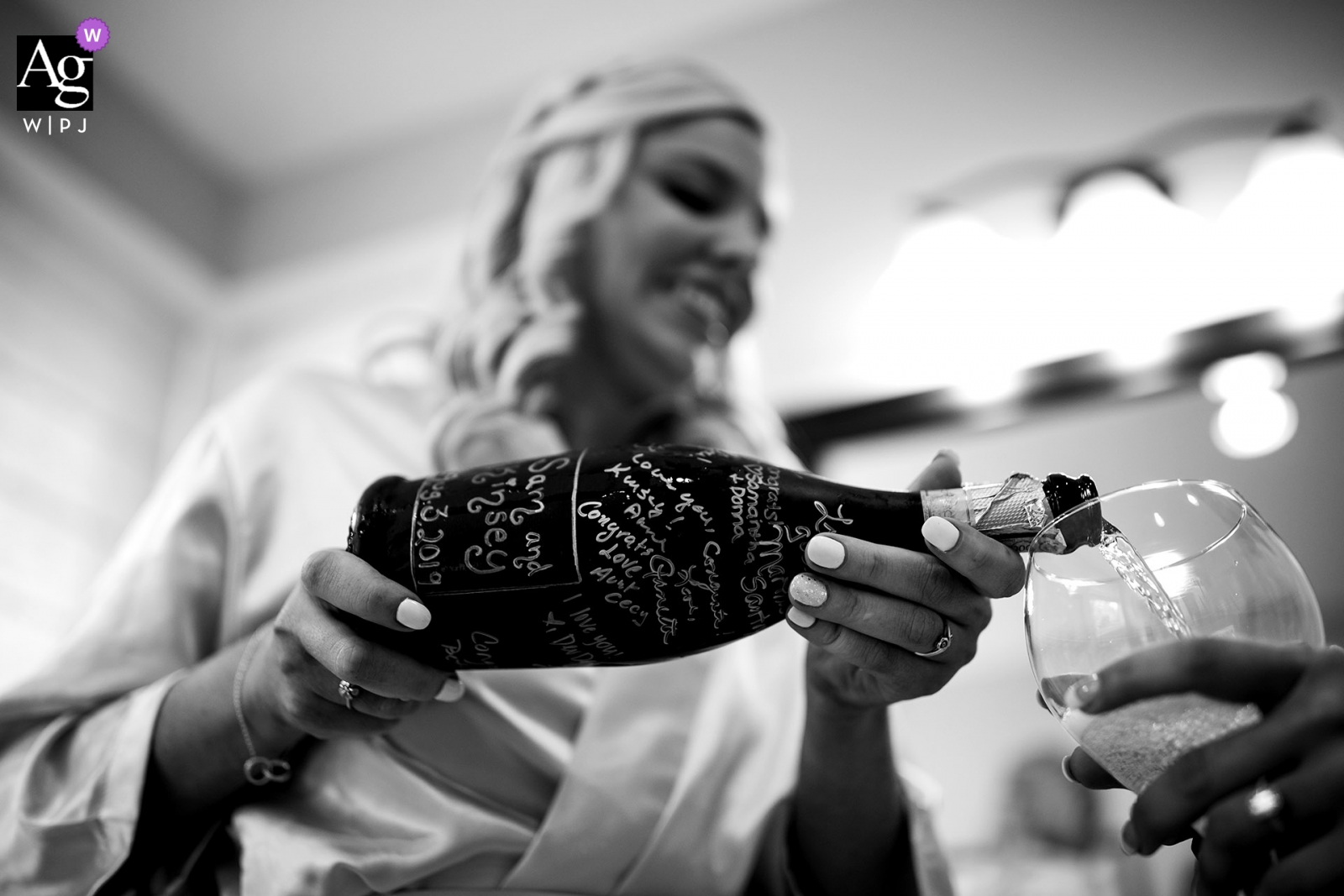 The Broadmoor Hotel, Colorado Springs, Colorado wedding venue photo - The maid of honor pours champagne that was inscribed by the brides friends on the wedding day.