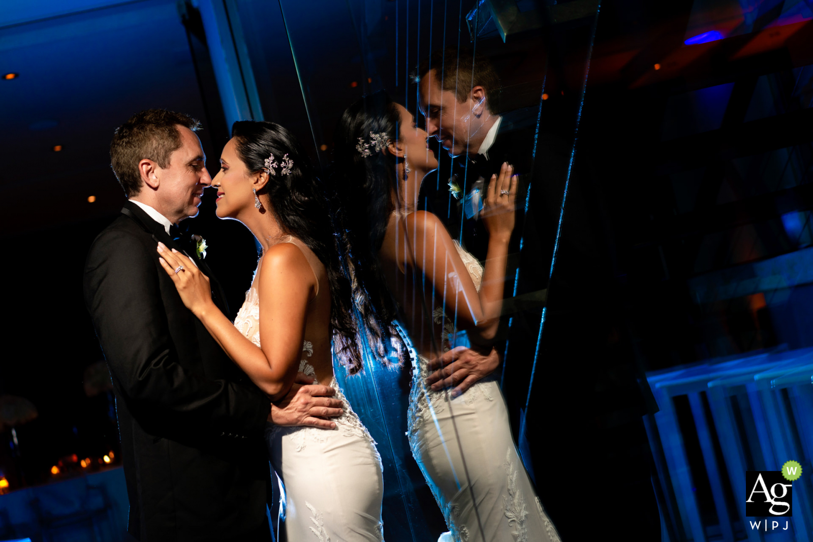 Reception - Condado Oceano Restaurant wedding venue photographer:  I used reflection, blue gel behind couple. 1 light over couple