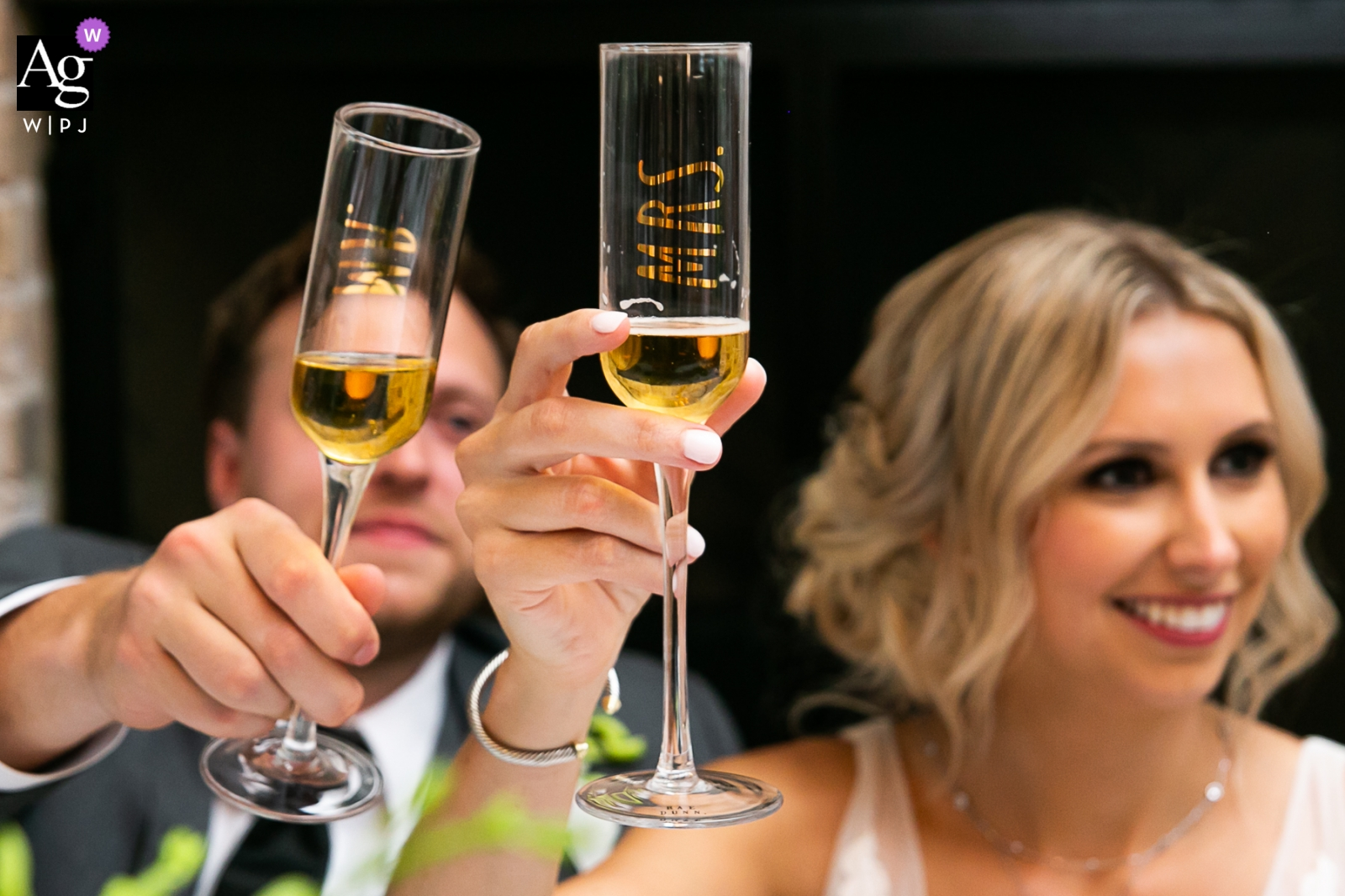 Wrightsville Manor, Wrightville, SC Wedding Couple Toasting Glasses at the Head Table