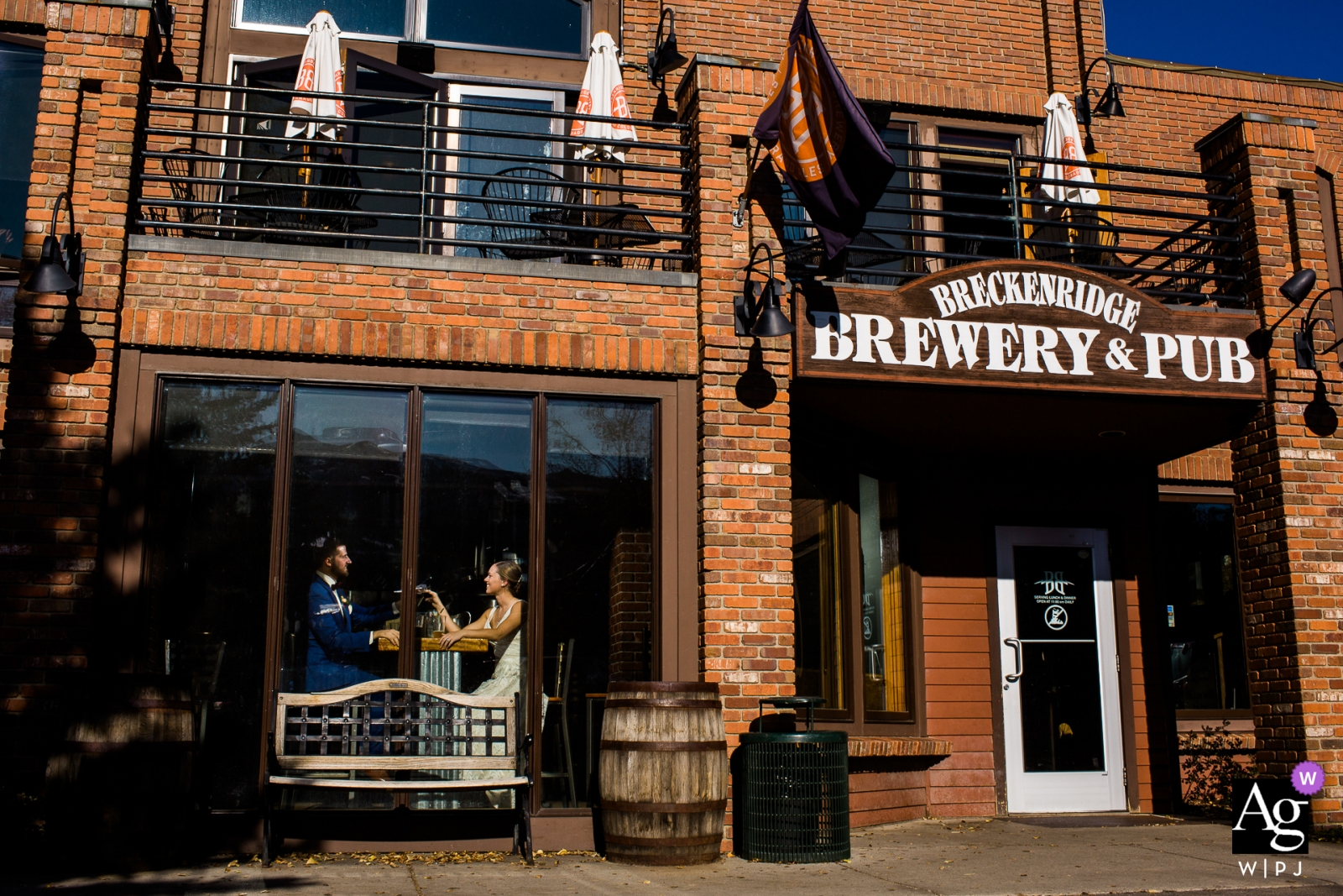 Colorado Brewery Couple enjoying happy hour together at brewery on wedding day