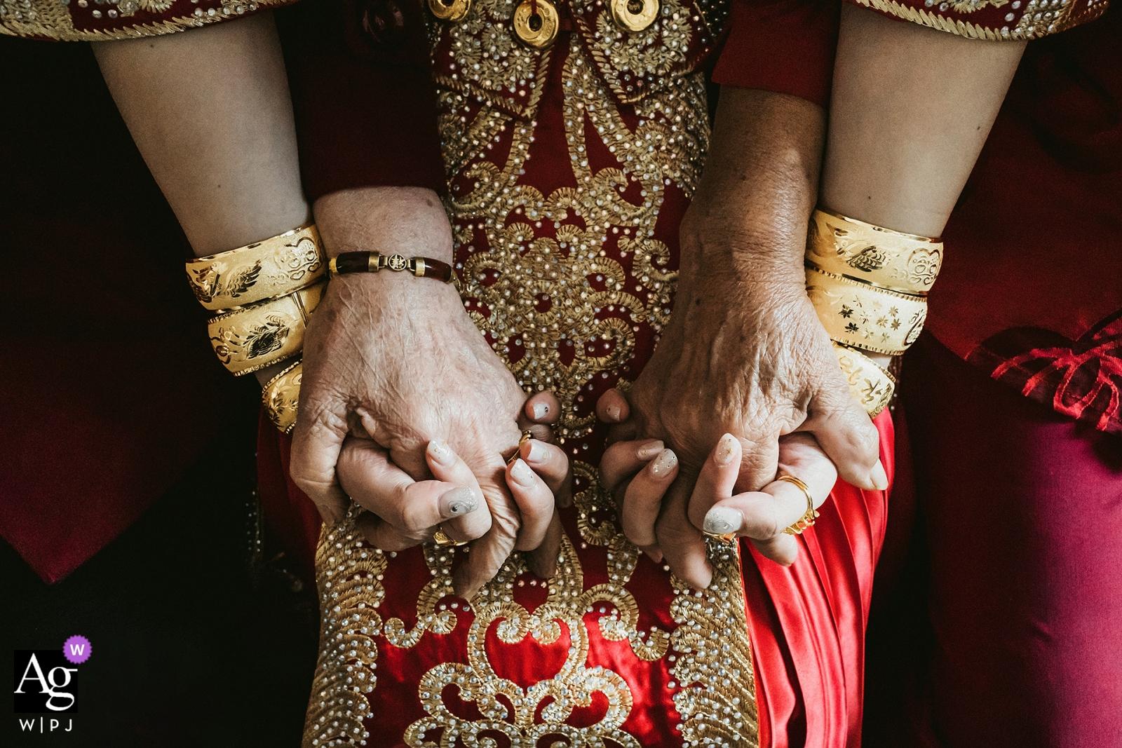 Fujian Bridal Detail Shot - Grandma and grandma hold the bride in both hands