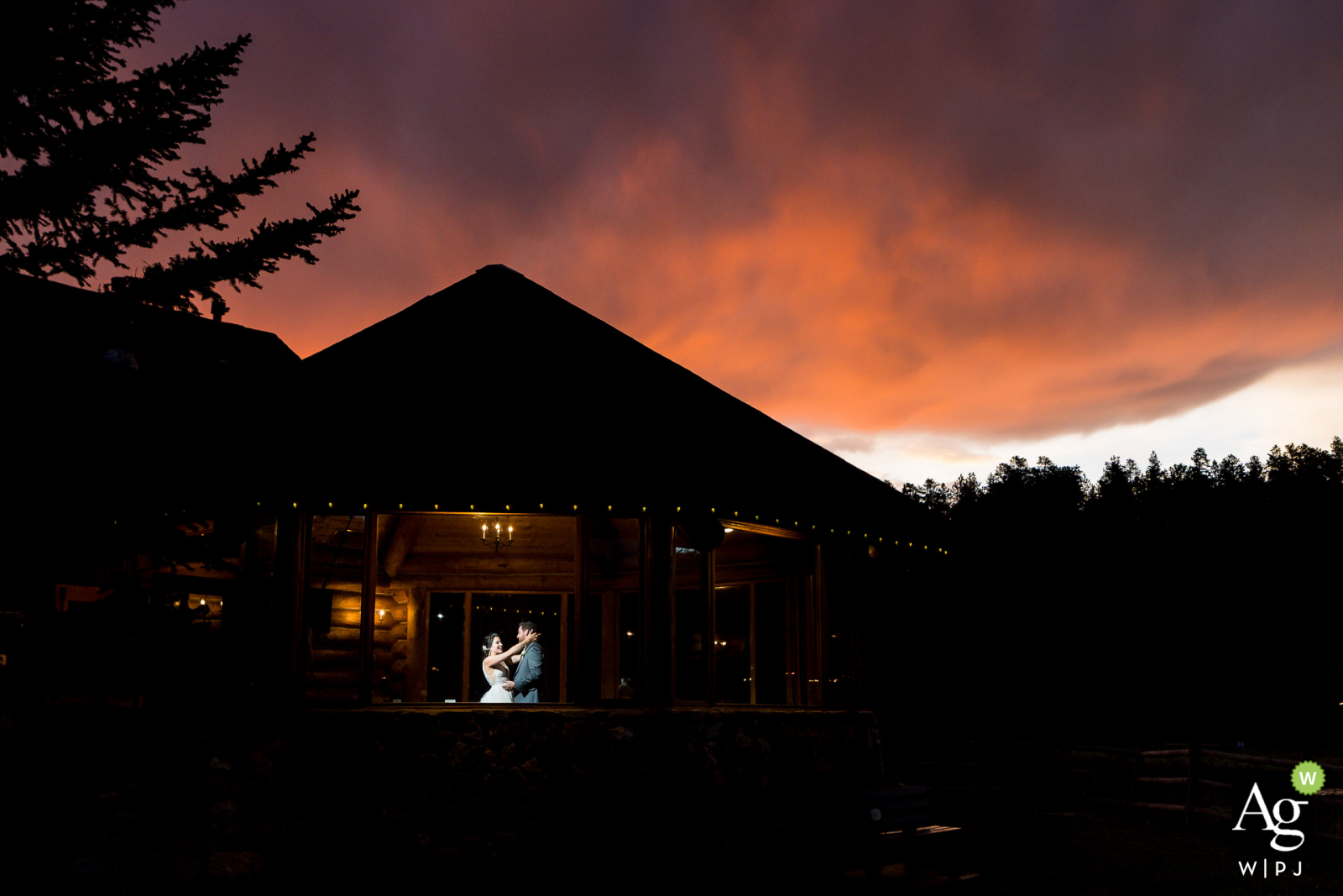 Evergreen Lakehouse wedding venue picture   Couple dancing in pavillion under sunset sky