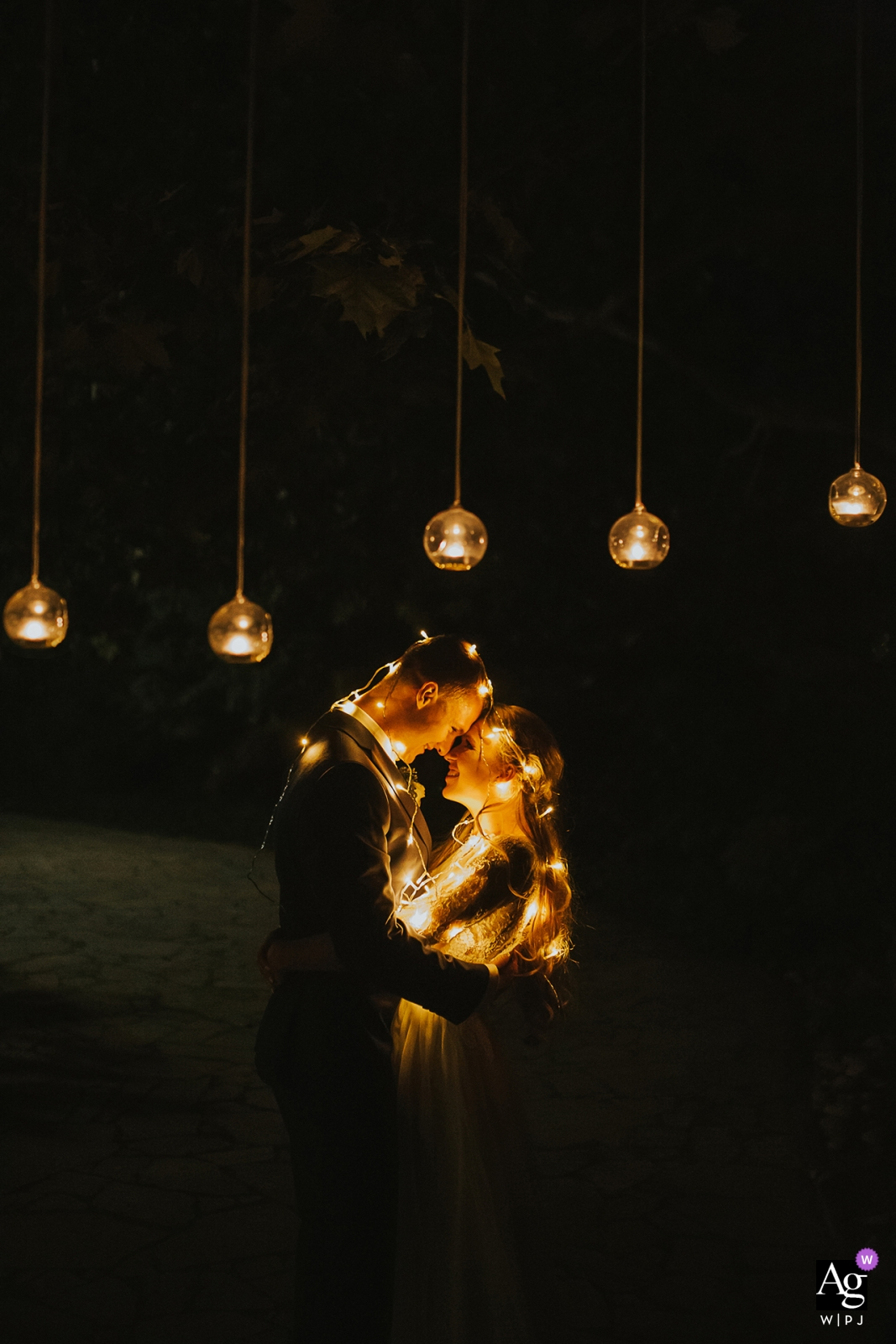 Castle Mierovo, Bratislava, Slovakia Bride and Groom portrait with soft, hanging lights at night