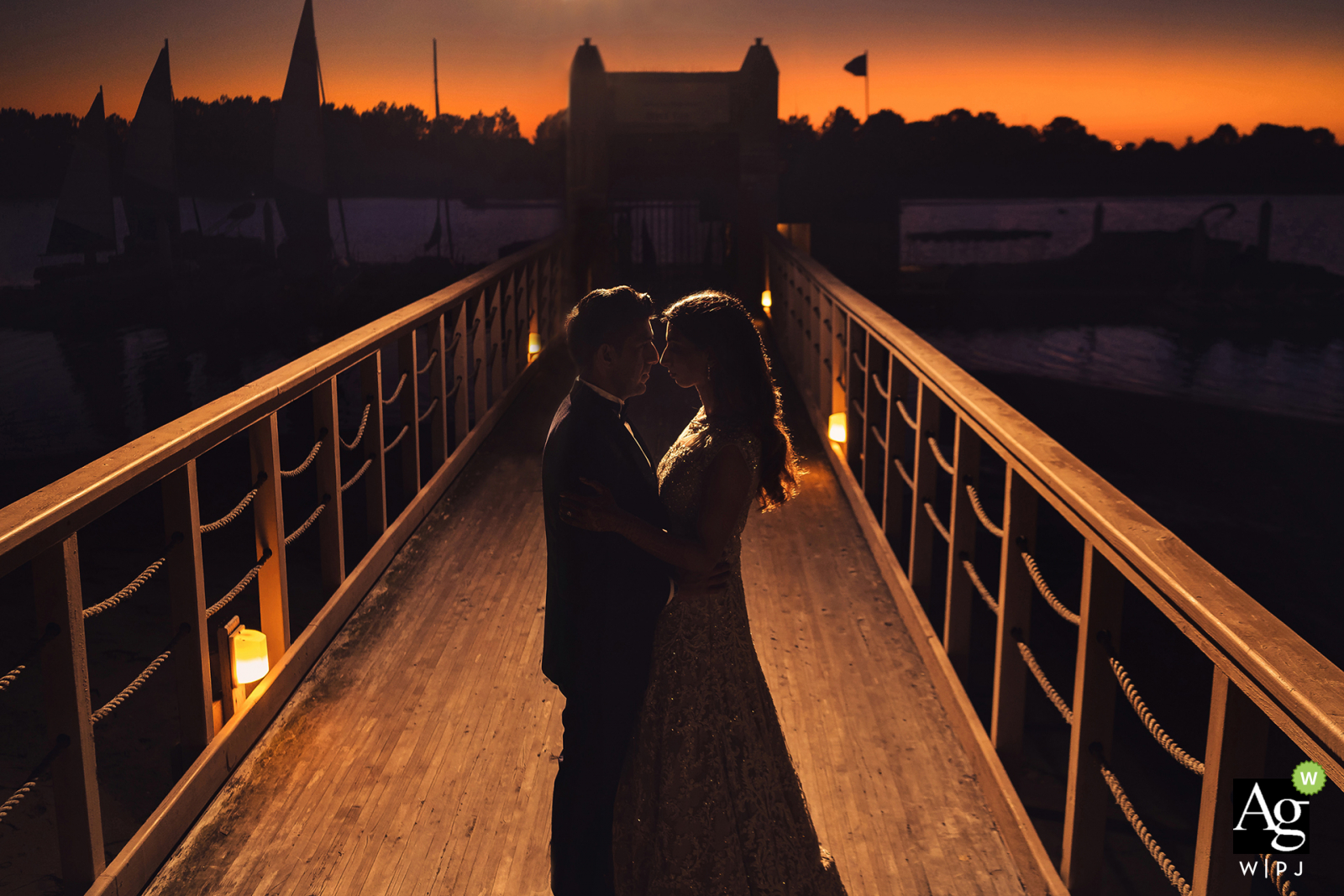 San Diego, Ca Bride and Groom on the harbor Pier | Wedding day portrait photo of the couple at sunset.
