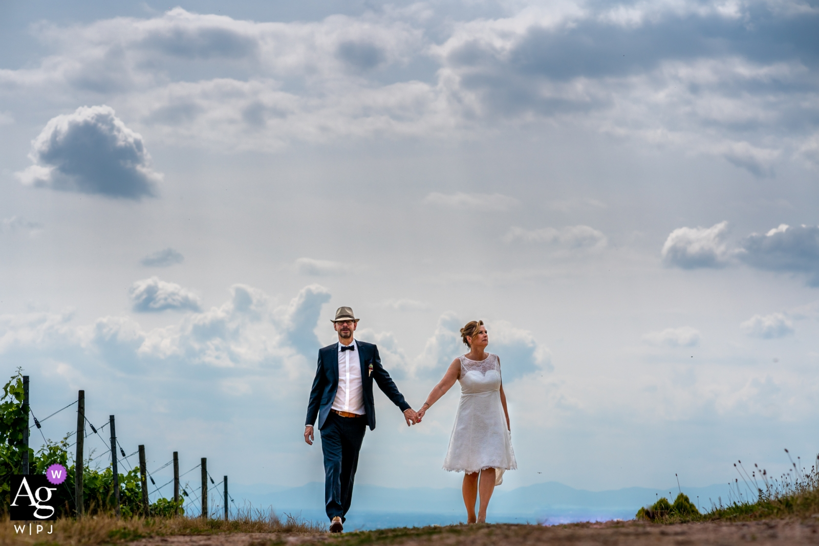 Durbach Couple walking together | Wedding portraits under the clouds