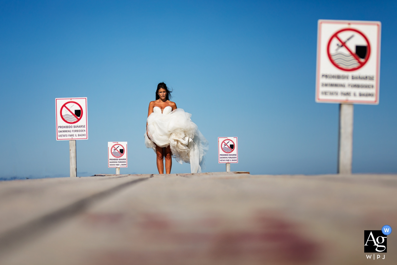 Formentera Island bride portrait at the beach in the sun with blue skies