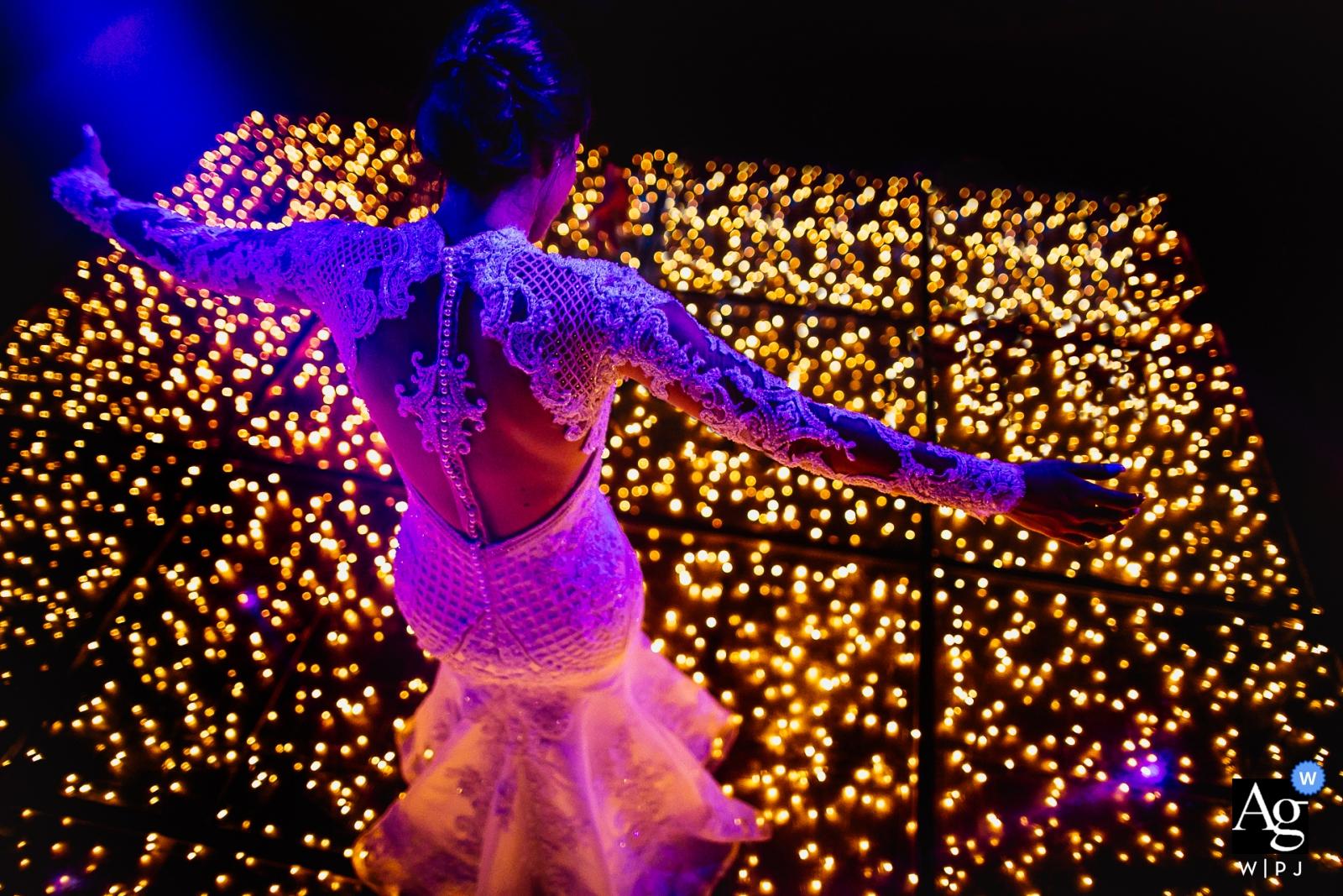 Casa Valduga - Bento Gonçalves - Rio Grande do Sul bride photo of her dancing on floor with lights.