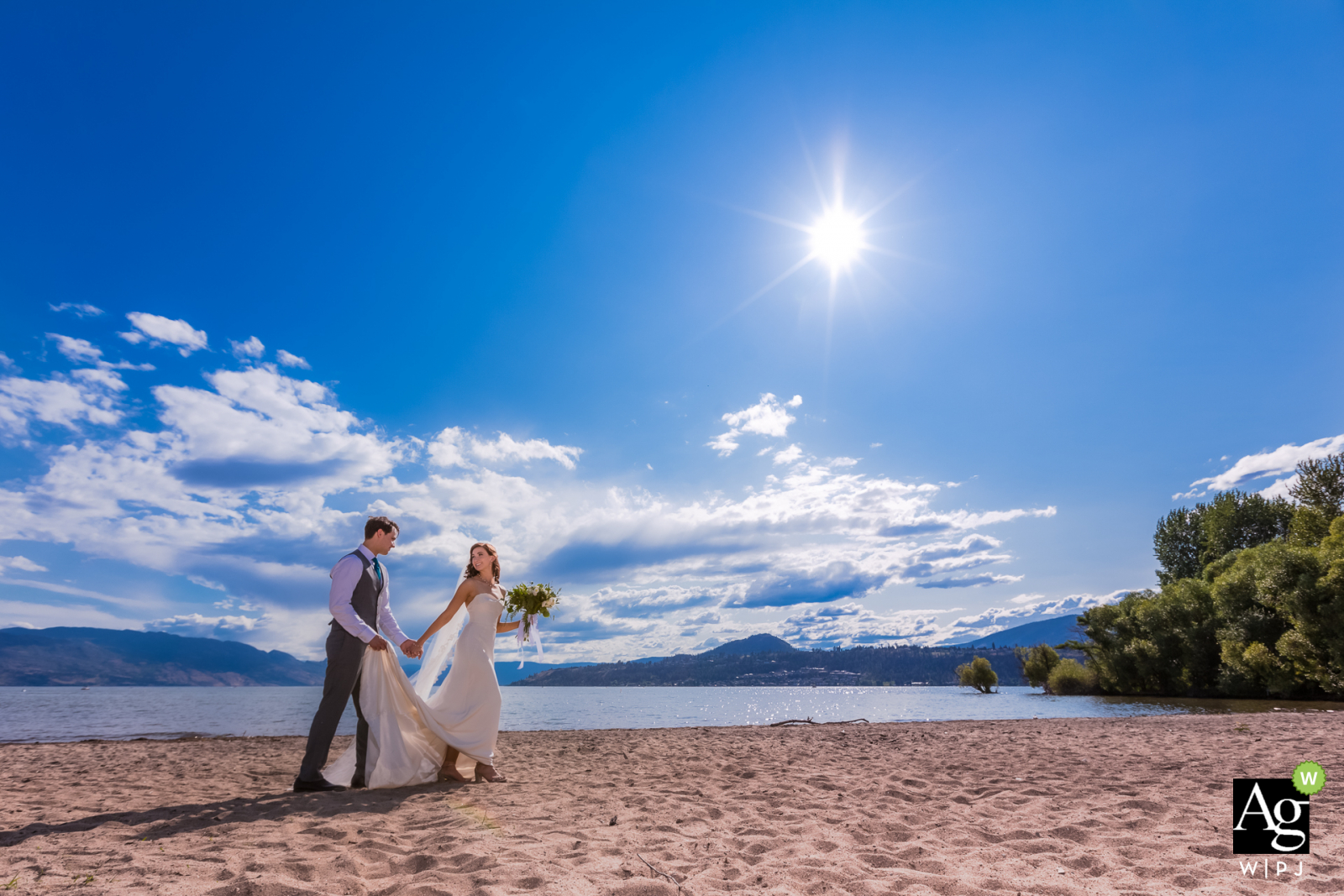 Okanagan Lake Wedding Photo - Couple strolling back to the limo from the beach
