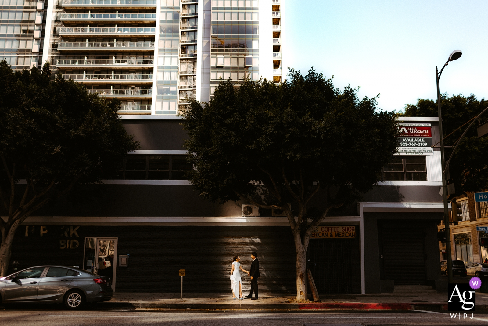 Los Angeles, CA creative wedding day portraits | Light hitting couple on street